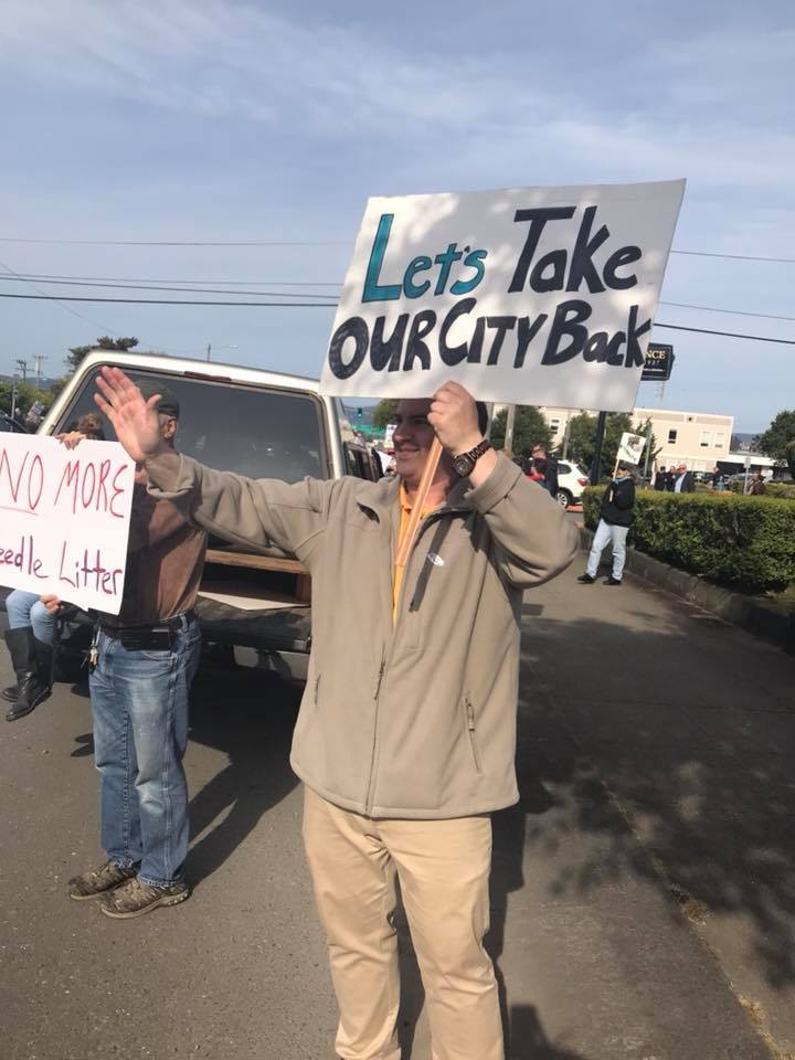 Anthony Mantova holds a sign for a better Eureka